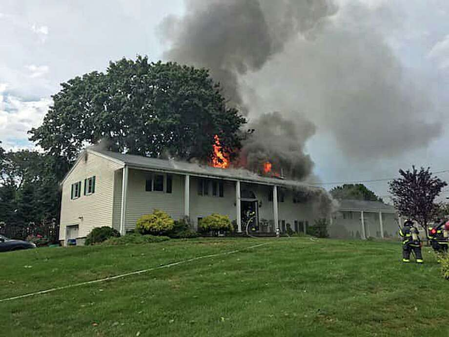 A Norwalk firefighter was injured after a lightning strike sparked a fire that heavily damaged a Richlee Road house late Monday afternoon. The two occupants of the home, two dogs and a cat were unharmed in the blaze, fire officials said. One firefighter was injured when sections of the ceiling fell on him knocking him temporarily unconscious. Photo: Norwalk Fire Department Photo