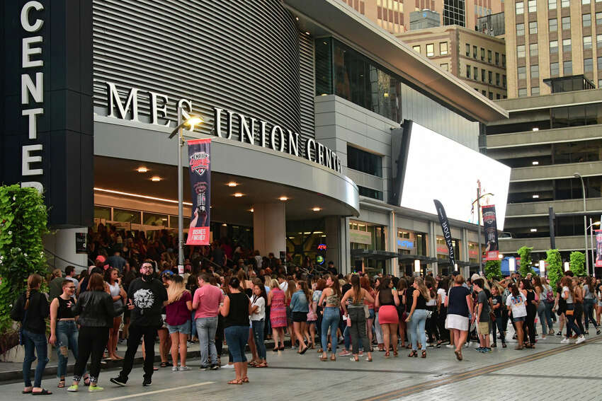 A crowd enters through the front doors to see the Jonas Brothers perform in concert at the Times Union Center on Monday, Aug. 19, 2019 in Albany, N.Y. (Lori Van Buren/Times Union)