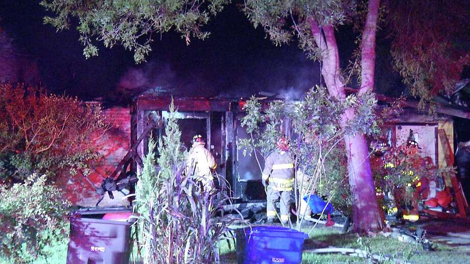 A Southwest Side home was destroyed after a fire burst the roof into flames Monday evening, San Antonio fire officials said. Photo: Ken Branca