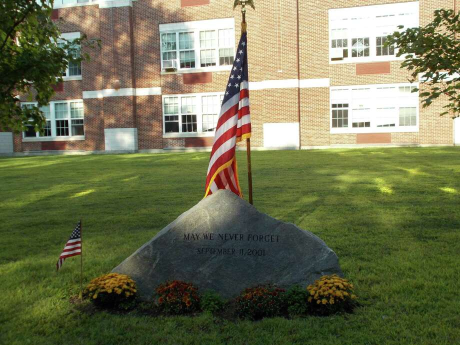 The public, including first responders, selectmen, local officials and Middlesex Middle School students is invited to attend the town's annual 9/11 remembrance ceremony. Photo: David Polett / Contributed Photo