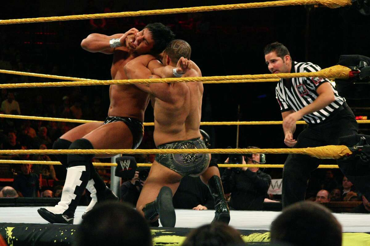 """David """"A-List"""" Otunga, right, works to take down Justin Gabriel in the WWE Smackdown's NXT rookie bout, at Mohegan Sun in Uncasville, Conn., on April 20, 2010. NXT, WWE's main showcase for up-and-coming talent, is set to start airing Sept. 18, 2019 on cable TV's USA Network."""