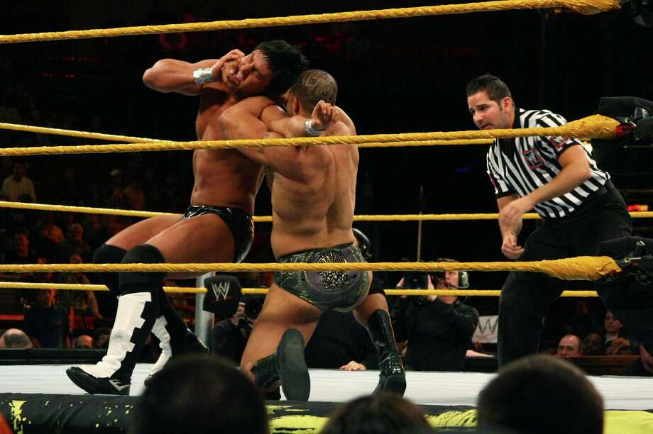 "David ""A-List"" Otunga, right, works to take down Justin Gabriel in the WWE Smackdown's NXT rookie bout, at Mohegan Sun in Uncasville, Conn., on April 20, 2010. NXT, WWE's main showcase for up-and-coming talent, is set to start airing Sept. 18, 2019 on cable TV's USA Network. Photo: Christian Abraham / ST / Connecticut Post no sale"