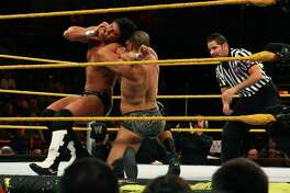 "David ""A-List"" Otunga, right, works to take down Justin Gabriel in the WWE Smackdown's NXT rookie bout, at Mohegan Sun in Uncasville, Conn., on April 20, 2010. NXT, WWE's main showcase for up-and-coming talent, is set to start airing Sept. 18, 2019 on cable TV's USA Network."