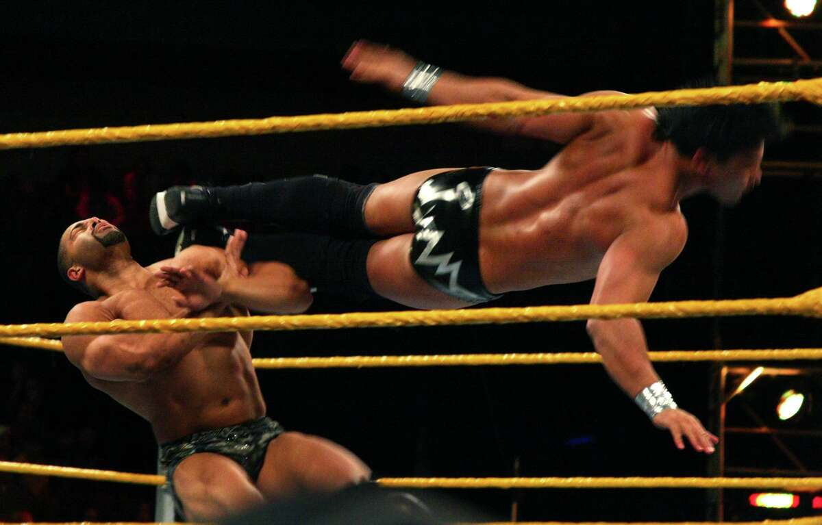 """David """"A-List"""" Otunga, left, gets a flying kick from Justin Gabriel in the WWE Smackdown's NXT rookie bout, at Mohegan Sun in Uncasville, Conn., on April 20, 2010. NXT, WWE's main showcase for up-and-coming talent, is set to start airing Sept. 18, 2019 on cable TV's USA Network."""