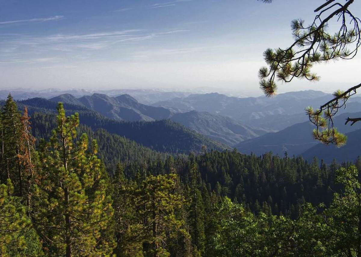 25. Kings Canyon - Location: California - Date established as park: March 4, 1940 - Area: 461,901 acres - Recreational visitors in 2019:632,110 - Recreational visitors in 2020:415,077 Kings Canyon resides in the southern Sierra Nevada mountains, adjacent to Sequoia National Park. Its dramatic geography-withglacial valleys, rocky outcrops, and expansive meadows, all of which was brought to prominence in the late 19th century by John Muir-is often compared to the legendary Yosemite. But one of its most well-known and visited features is Grant Grove, an expanse of mighty redwoods, and home to the General Grant Tree, one of the largest living trees in the world.
