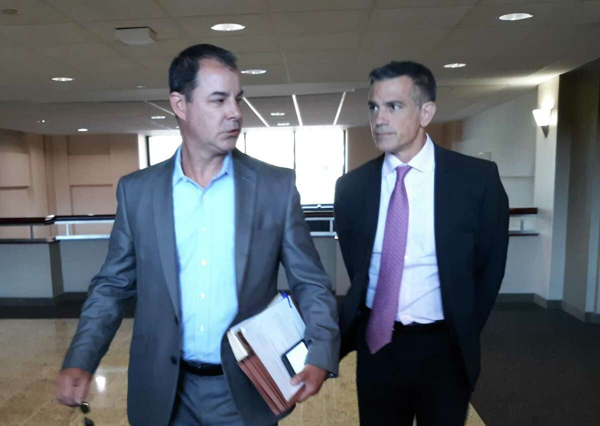 Fotis Dulos, right, arrives with his attorney William Murray on Tuesday to be deposed in his mother-in-law's civil lawsuit.