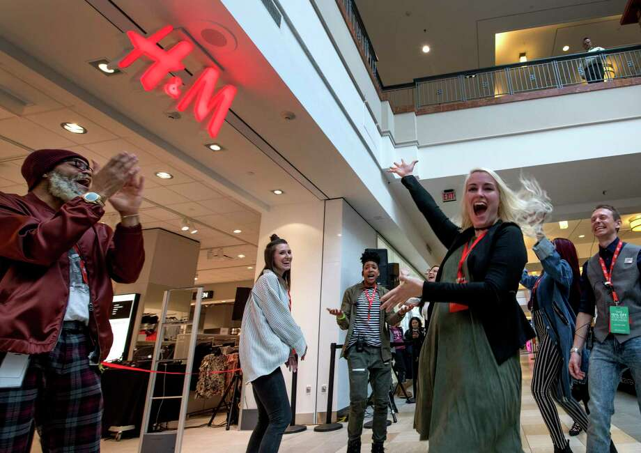 Employees celebrate the February 2018 opening of an H&M store in Colonie, N.Y. The apparel retailer opens its latest Connecticut store on Thursday, Aug. 22, at Danbury Fair mall. Photo: SKIP DICKSTEIN / Albany Times Union / 20042789A