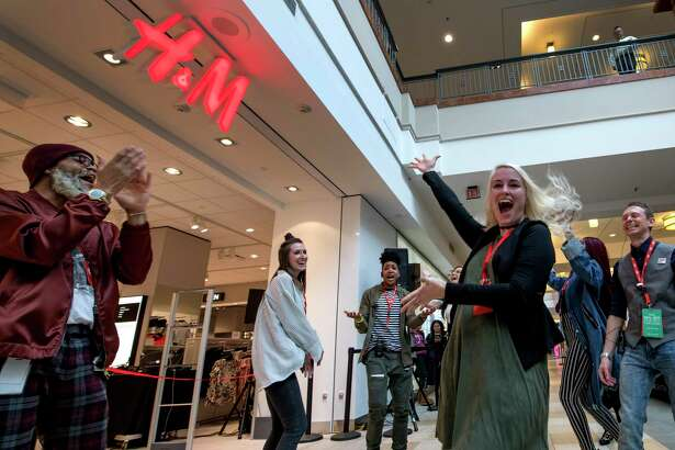 Employees celebrate the February 2018 opening of an H&M store in Colonie, N.Y. The apparel retailer opens its latest Connecticut store on Thursday, Aug. 22, at Danbury Fair mall.