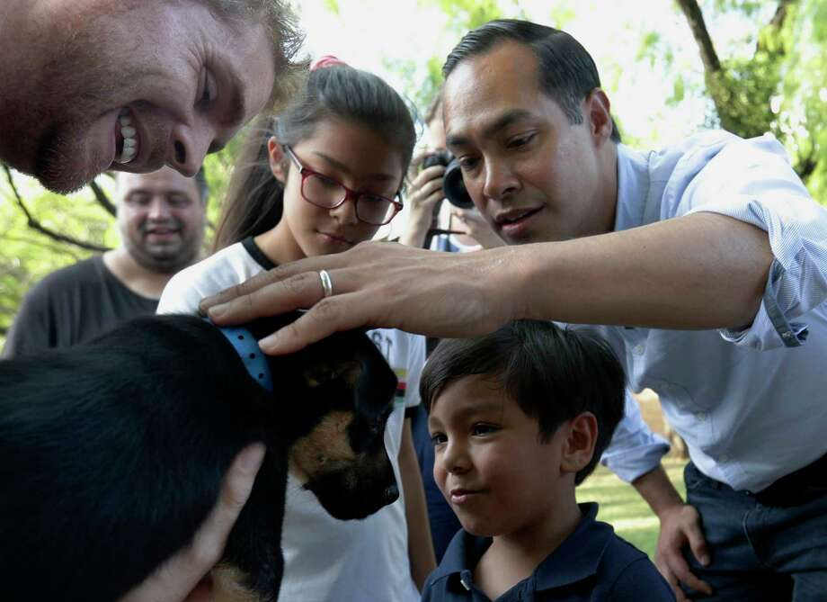 Democratic presidential candidate and former Housing Secretary Julian Castro, right, with his son Cristian, and daughter Carina, visit with Ivan, a puppy up for adoption, during a stop at the Animal Defense League of Texas shelter, Monday, Aug. 19, 2019, in San Antonio. (AP Photo/Eric Gay) Photo: Eric Gay, Associated Press / Copyright 2019 The Associated Press. All rights reserved.