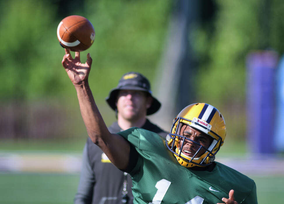 UAlbany football quarterback and running back Jah Dabney throws a pass during practice on Tuesday, Aug. 20, 2019, in Albany, N.Y. (Paul Buckowski/Times Union)