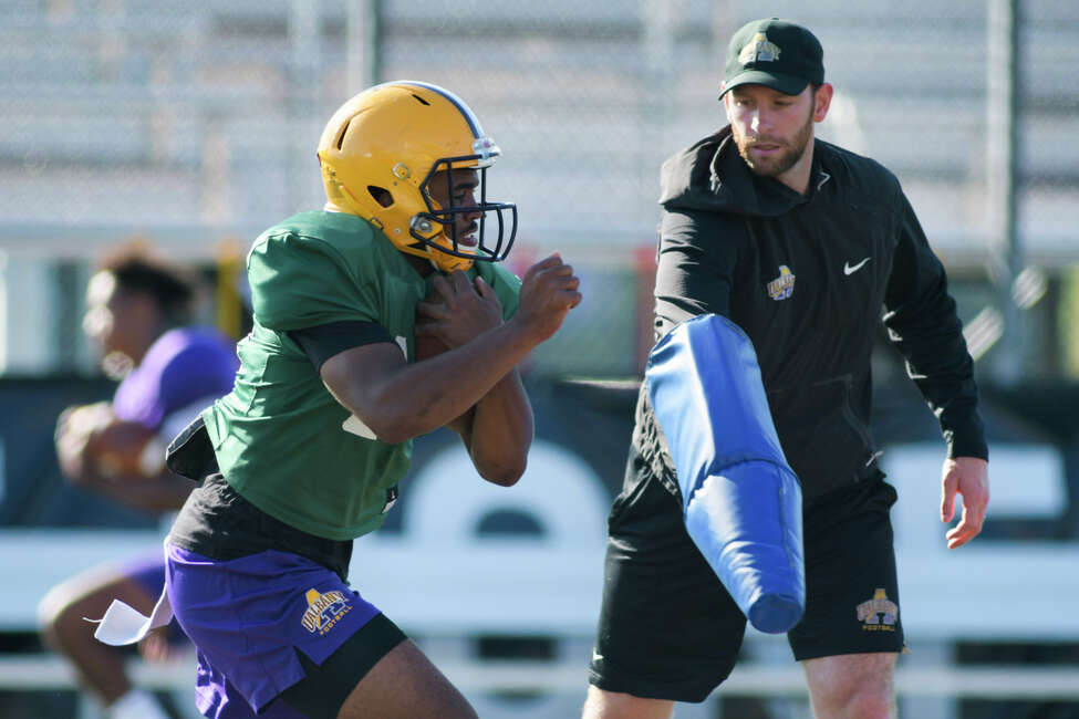UAlbany football quarterback and running back Jah Dabney runs through drills during practice on Tuesday, Aug. 20, 2019, in Albany, N.Y. (Paul Buckowski/Times Union)