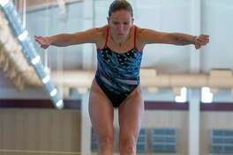 Laura Wilkinson jumps backwards from a diving board during a training session Friday, August 16, 2019 at the Conroe ISD Natatorium in Shenandoah.