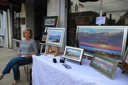 The Art Society of Old Greenwich will be hosting its 68th annual Sidewalk Art Show & Sale September 14-15. Gail Bell with her landscapes at last year's event.
