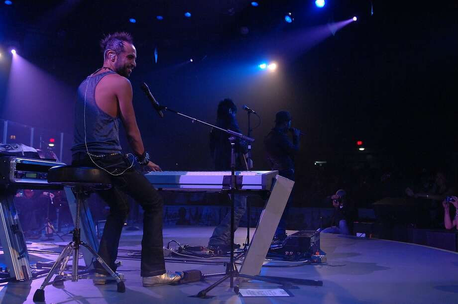 Mario Domm (Keyboards and voice) of Camila performs at Arena Theater. Photo: Tre' Ridings, For The Chronicle