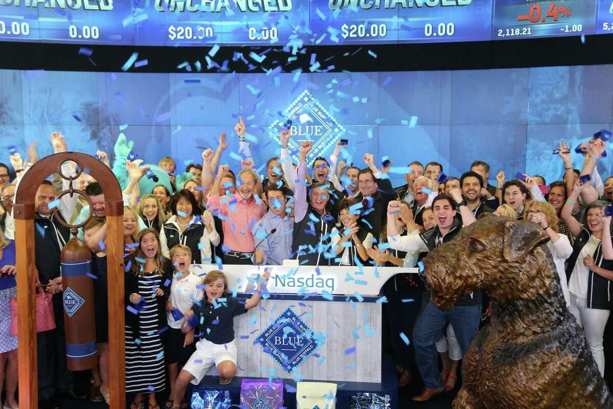 """Blue Buffalo """"herd members"""" ring the opening bell for the Nasdaq on Wednesday, July 22, 2015, marking the initial public offering of stock for the premium pet food maker based in Wilton, Conn. Photo courtesy Nasdaq."""