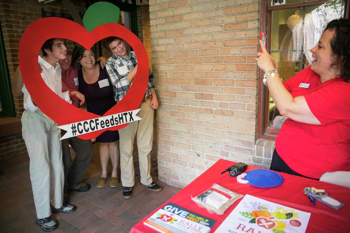 Church-goers pose with an apple frame last Sunday to promote Christ Church Cathedral's Rally Against Hunger.