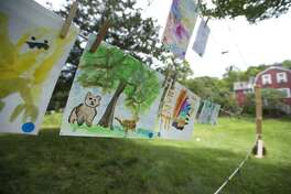 Completed works of art hang on display during the Art in the Park Festival at Weir Farm in Wilton, Conn. on Saturday, Aug. 25, 2018.