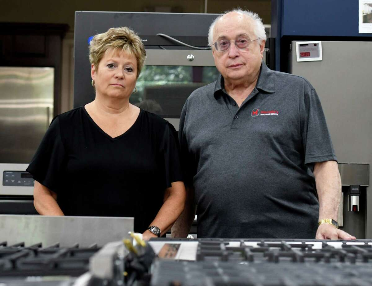 John D. Marcella, proprietor of Marcella Appliances, right, and Lori Juliano, general manager and Marcella's longtime partner, left, on Wednesday, Aug. 14, 2019, at Marcella Appliances in Schenectady, N.Y. (Will Waldron/Times Union)