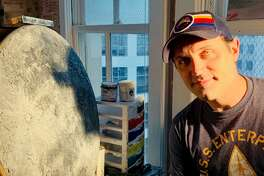 His experiences with astronauts and Space Center Houston stuck with theater teacher H.R. Bradford, who recently made a painting of the moon.