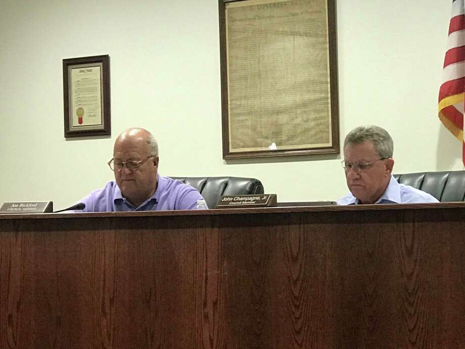 Following a dismissed case, the city of Montgomery is stepping up its enforcement to stop illegal fishing at Memory Park with criminal penalties. Councilman John Champagne (RIGHT) moved to pass the law, which received the unanimous support of the council, including Councilman Jon Bickford (LEFT). Photo: Meagan Ellsworth / Meagan Ellsworth