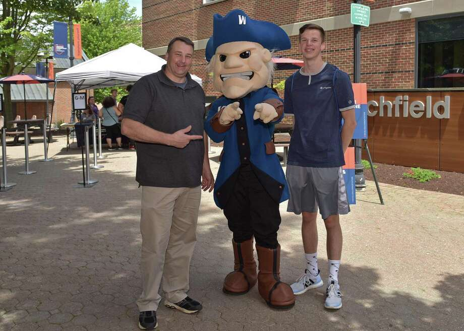 Father and son Doug and Brandon Muckerman with WCSU mascot Colonial Chuck at the university's summer orientation last month. The New Milford residents are both incoming students this fall. Photo: Contributed Photo / Peggy Stewart