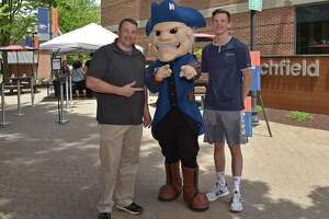 Father and son Doug and Brandon Muckerman with WCSU mascot Colonial Chuck at the university's summer orientation last month. The New Milford residents are both incoming students this fall.