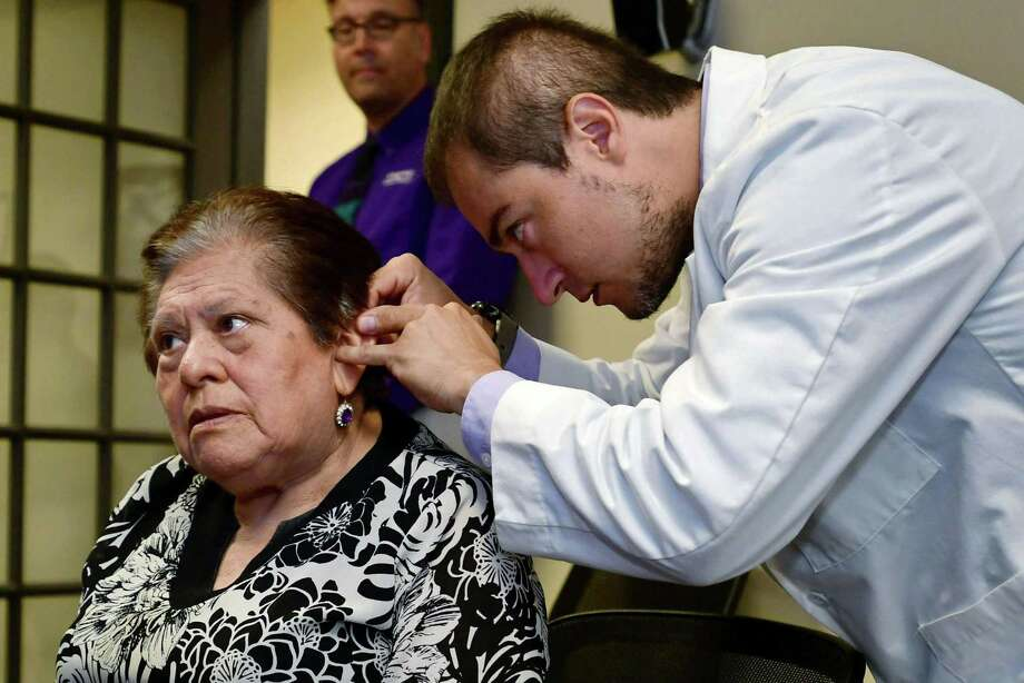Kingsway Senior Housing resident Julia Ilizarbe, 82, receives new hearing aids from John Bermudez, Beltone hearing consultant, Tuesday, August 20, 2019, at the Beltone Hearing Center in Norwalk, Conn. Bermudez helped facilitate her application to the Beltone Hearing Care Foundation which supplied the new hearing aids at no cost. Photo: Erik Trautmann / Hearst Connecticut Media / Norwalk Hour