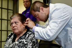 Kingsway Senior Housing resident Julia Ilizarbe, 82, receives new hearing aids from John Bermudez, Beltone hearing consultant, Tuesday, August 20, 2019, at the Beltone Hearing Center in Norwalk, Conn. Bermudez helped facilitate her application to the Beltone Hearing Care Foundation which supplied the new hearing aids at no cost.