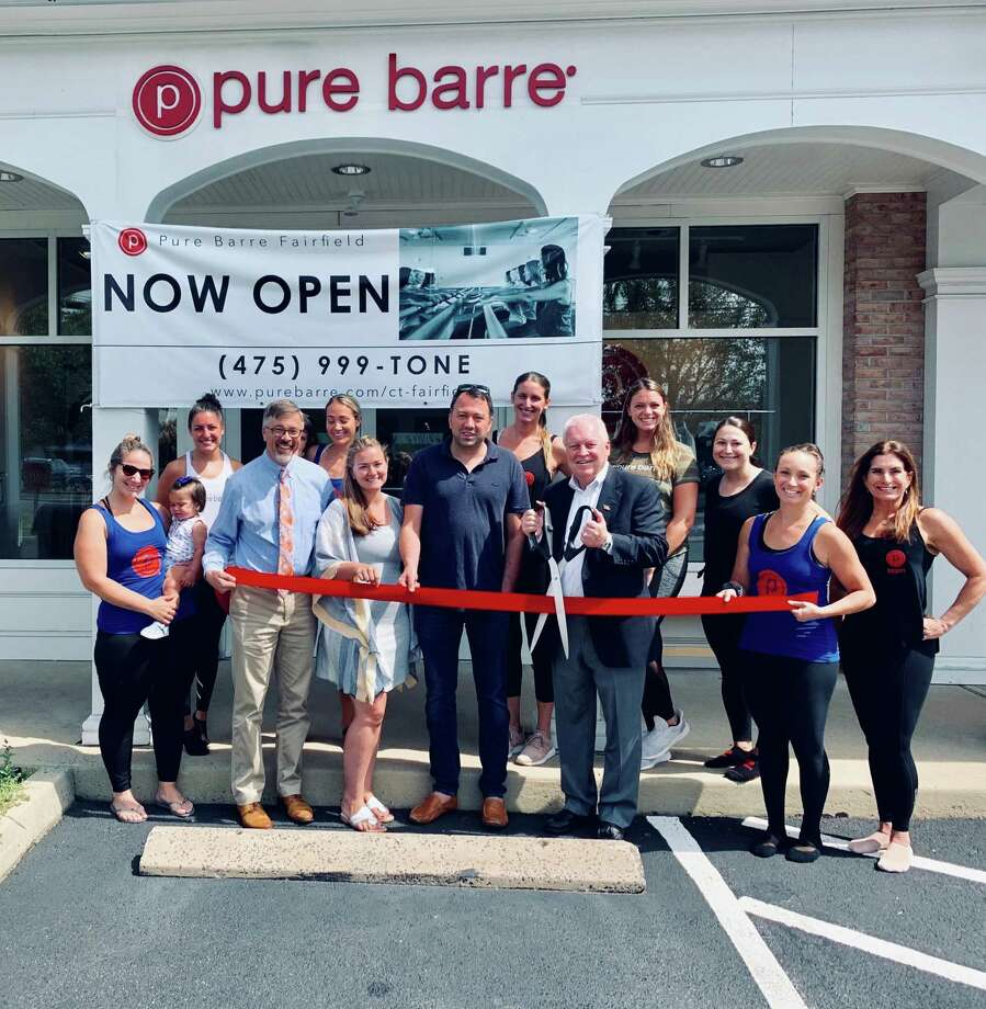 First Selectman Mike Tetreau cuts the ribbon at the new Pure Barre location at 1876 Black Rock Turnpike. Photo: Contributed Photo