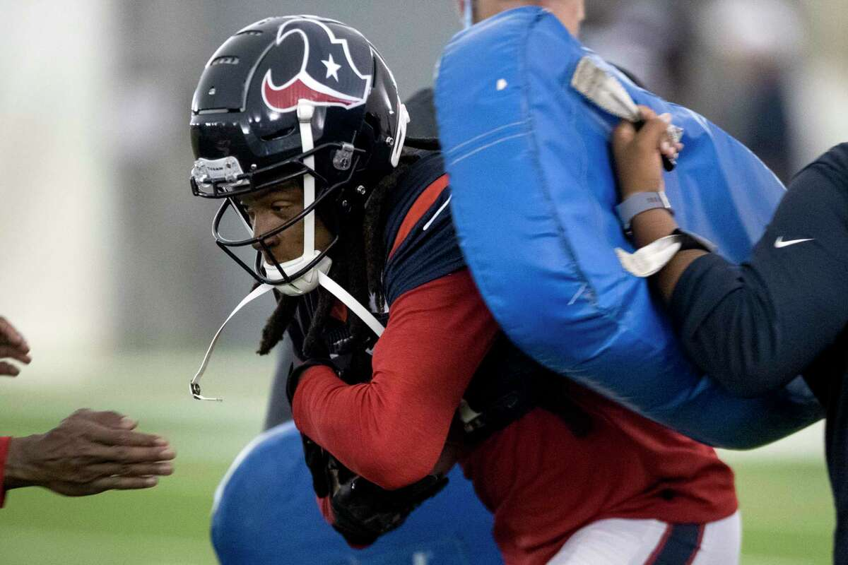 Houston Texans wide receiver DeAndre Hopkins runs through a pair of blocking pads during training camp at the Methodist Training Center on Tuesday, Aug. 20, 2019, in Houston.