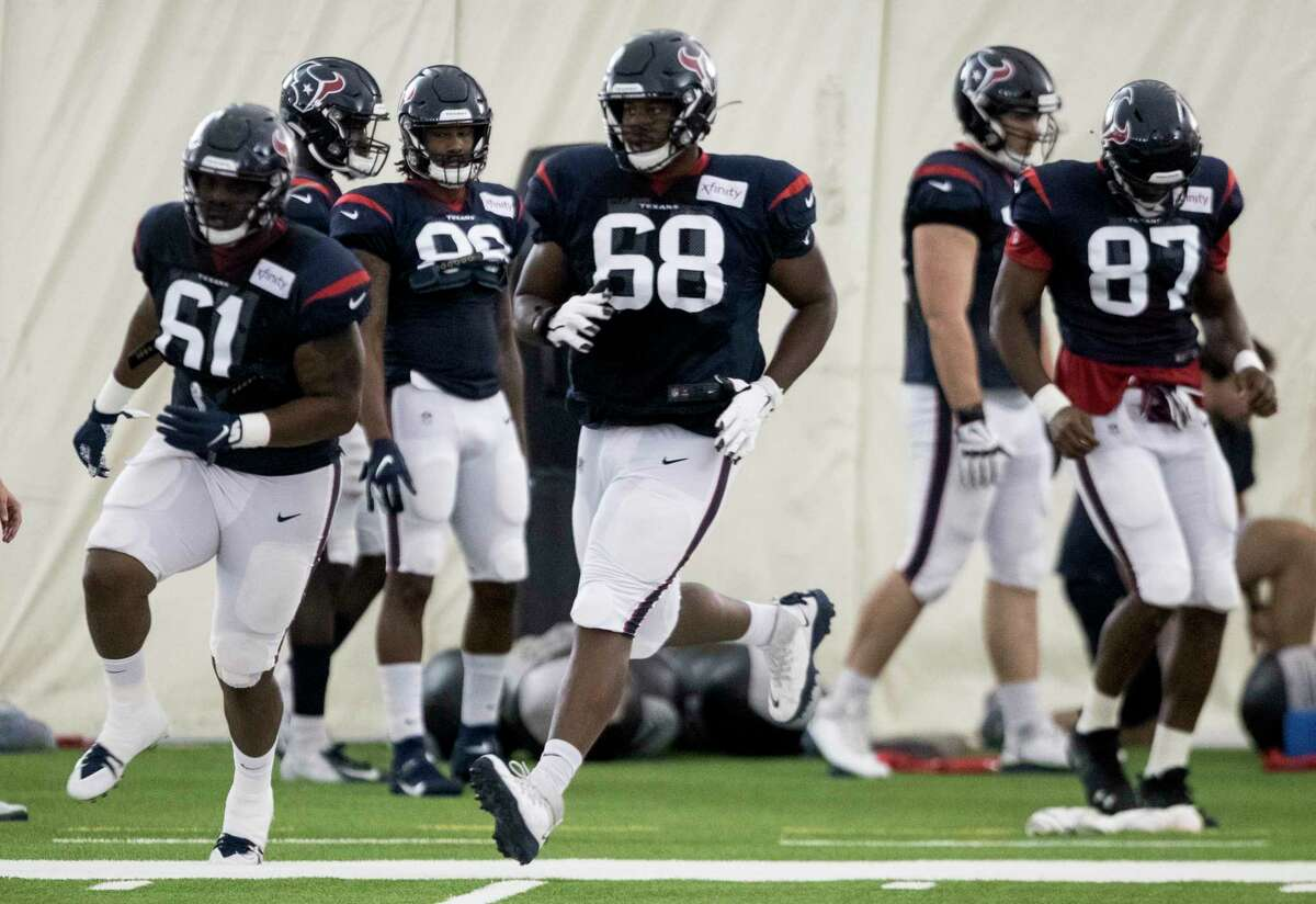 Houston Texans offensive guards Maurquice Shakir (61) and Malcolm Pridgeon (68) run a drill during training camp at the Methodist Training Center on Tuesday, Aug. 20, 2019, in Houston.