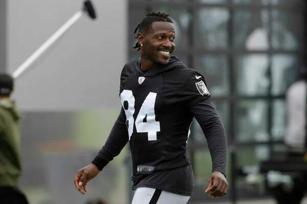 Oakland Raiders' Antonio Brown smiles before stretching during NFL football practice in Alameda, Calif., Tuesday, Aug. 20, 2019.