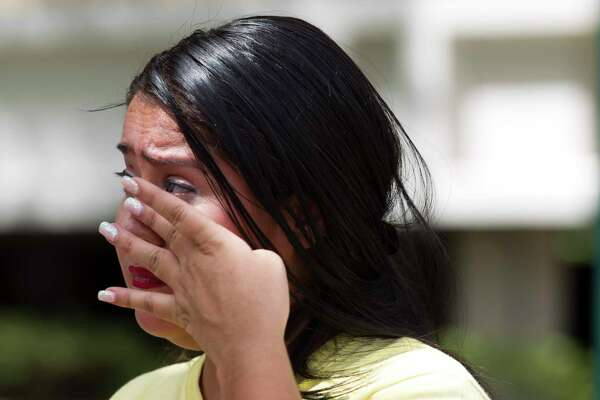 Yancy Balderas wipes aware tears as she shares her views on capital punishment as she and others gather outside the Montgomery County Courthouse in support of Larry Swearingen, Tuesday, Aug. 20, 2019, in Conroe. Balderas' husband, Juan, is on death row for a gang related shooting in 2005. Swearingen was sentenced to die nearly two decades ago, after a jury convicted him of raping and murdering 19-year-old Montgomery County college student Melissa Trotter, then dumping her body in Sam Houston National Forest. Swearingen has dodged five execution dates since his original execution data in 2007, and is schedule to die by lethal injection in Huntsville on Aug. 21. Previously, his date was reset in October 2017 because the Montgomery County District Clerk's office sent the execution order to the wrong place.