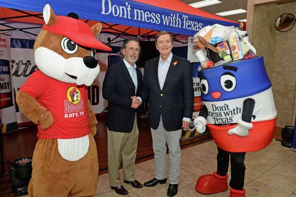 """Buc-ee's Founder Arch """"Beaver"""" Aplin, left, poses with Texas Transportation Commission Chairman, Commissioner J. Bruce Bugg, Jr. during the announcement of the collaboration of Buc-ee's with the Don't Mess With Texas Program at the Katy Buc-ee's on Tuesday, Aug. 20."""