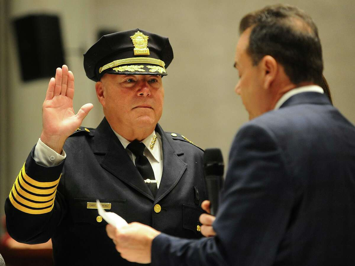"""Armando """"A.J."""" Perez is sworn in as Bridgeport police chief by Mayor Joseph Ganim in a ceremony at City Hall in Bridgeport, Conn. on Tuesday, November 13, 2018. Perez had been acting chief for two-and-a-half years."""