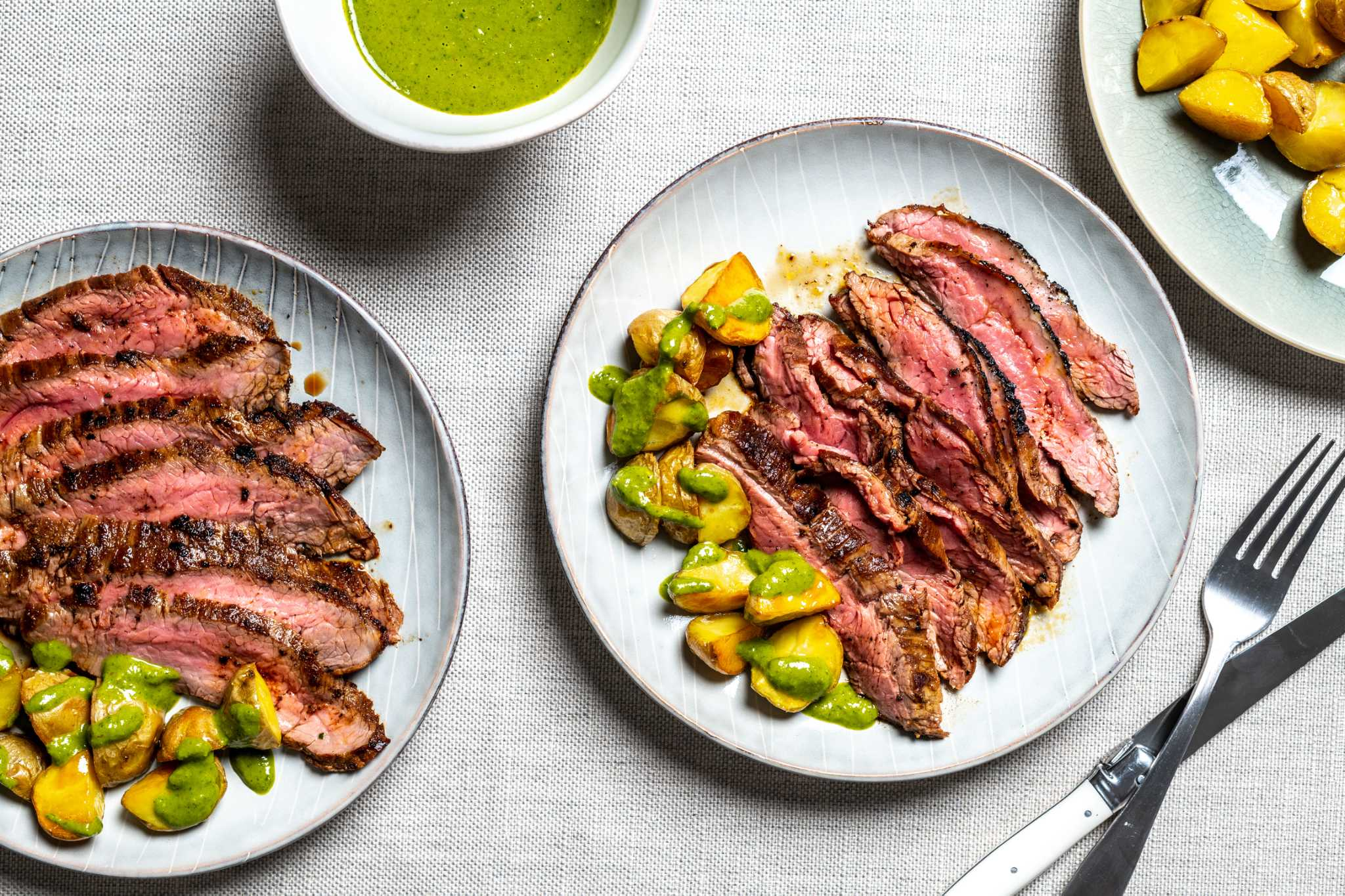 Step up your steak night with cumin-rubbed flank and chimichurri potatoes