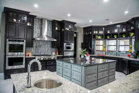 Although open kitchen cabinets are losing favor for storing everyday items, in many cases they're being installed above the main cabinets and used to display collectibles, small plants, even children's artwork.