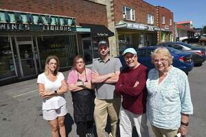 From left, business owners Anne Leonelli-Gallo of Niskayuna Wines and Liquors, Theresa Bolger of Niskayuna Barber Shop, Michael Kanciruk of Compute RX, Greg Salomon of Nott Street Office, and Gail King of Gail King Electrolysis Permanent Hair Removal stand in front of the Niskayuna Coop Plaza near the intersection of Nott Street and Balltown Road on Tuesday, Aug. 20, 2019 in Niskayuna, N.Y. (Lori Van Buren/Times Union)