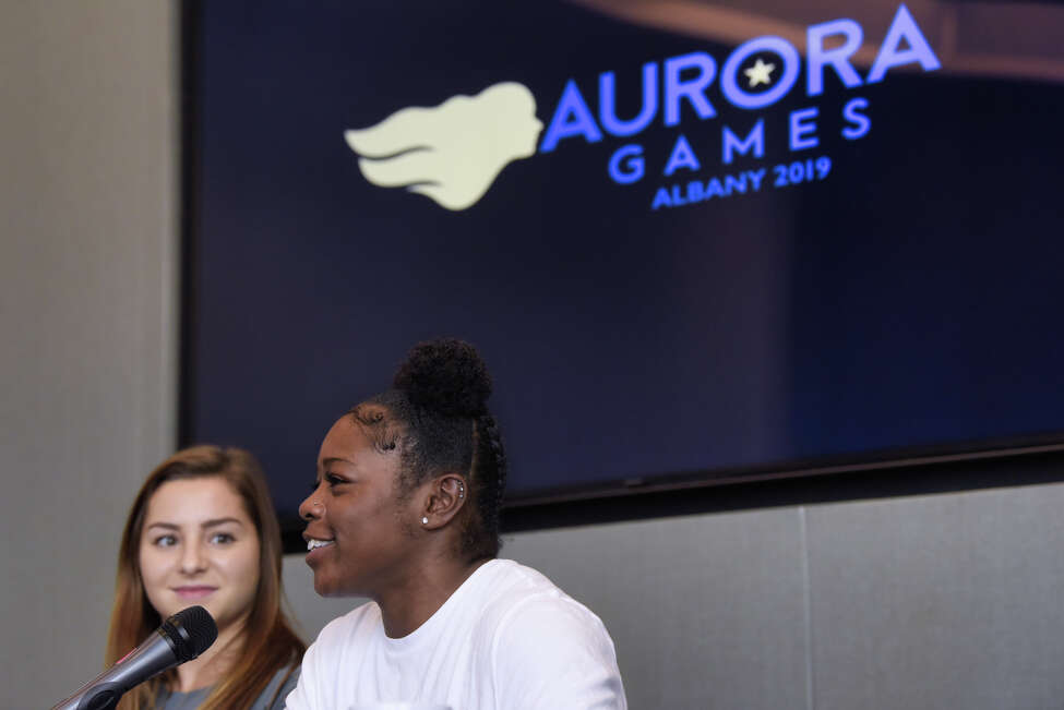 Former LSU gymnast McKenna Kelley, left, looks on as former University of Florida gymnast Alicia Boren talks during an Aurora Games press conference at the Albany Capital Center on Tuesday, Aug. 20, 2019, in Albany, N.Y. (Paul Buckowski/Times Union)