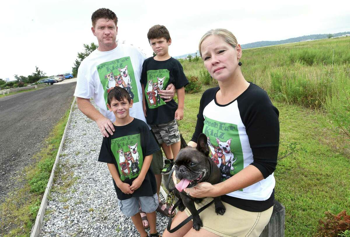 Meli Garthwait, right, of West Haven with her husband, Tommy Green, and their boys, Caleb, center, 8, and Liam, 6, at the Sandy Point Beach and Bird Sanctuary in West Haven on August 17, 2019. The family runs the dog rescue organization Green Fur Kidz.