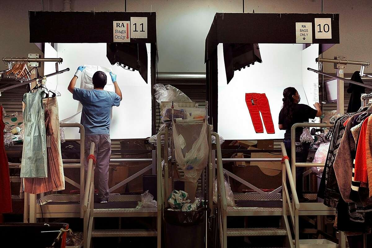 Mercers check clothing at the ThredUP warehouse in San Leandro, Calif., on Friday, February 6, 2015.
