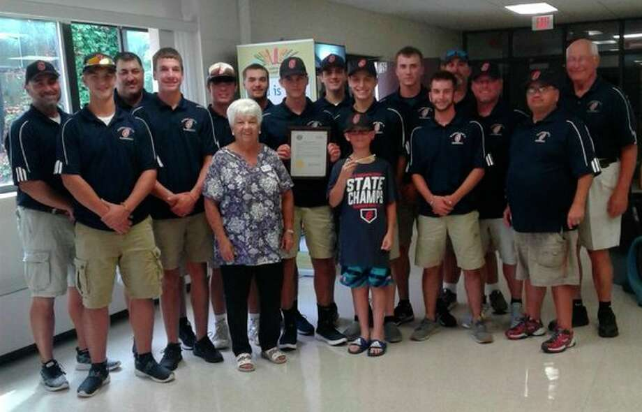 Pictured are (front row, from left) Jarrett Inscho, Mayor Dee Jungman, Hayden Novak (holding the key to the city), Drew Grove, coach Mark Novak; (back row, from left) coach Ryan Raymond, coach Scott Brokoff, Trent Reed, John Cogswell, Hunter Merillat, Garrett Stockford (holding the mayoral proclamation), Chase Raymond, Reed Raymond, Carson Longstreth, coach Dan Merillat, coach DR Cantrell, manager Terry Brokoff. Not pictured are Lane Peters, Jonas Kanouse, Garhet Metiva, Dane Smitz and Lucas Schweinsberg. (Photo provided)