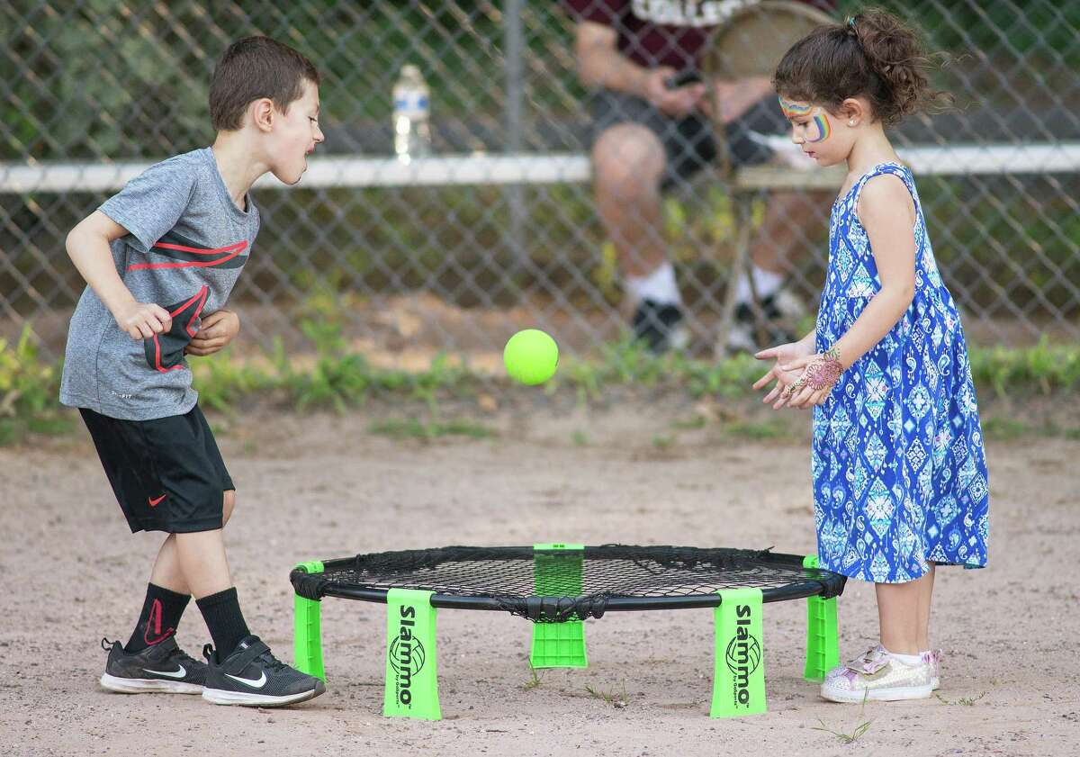Bobby Prusak, 6, and his sister, Sadie, 4, of Wilton play catch at the 2nd annual Wilton Food Truck Festival.