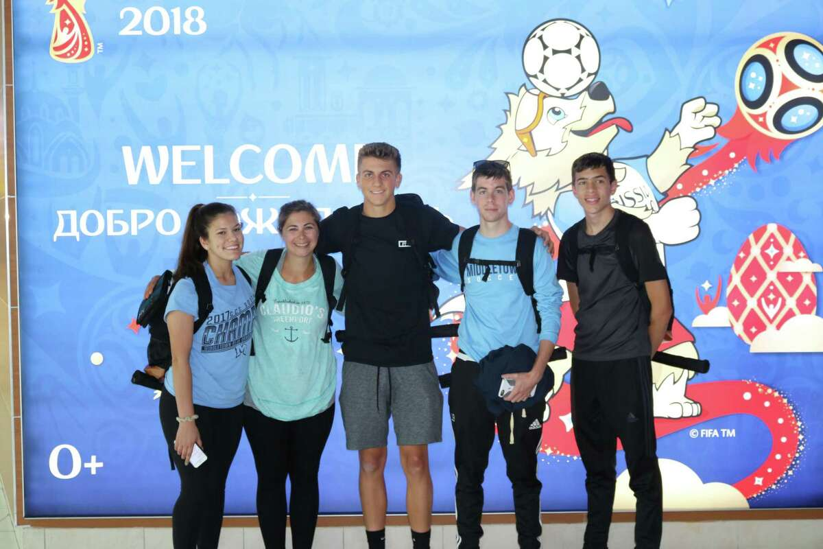 Carson Fitzner, center, a 2018 graduate of Middletown High School, runs the videotaping business Fitzner Productions. He's shown here with fellow students last June on a trip to Russia to see the World Cup. Fitzner's video so impressed the Eurasia Foundation of Washington, D.C., that it was selected as a top contest winner.