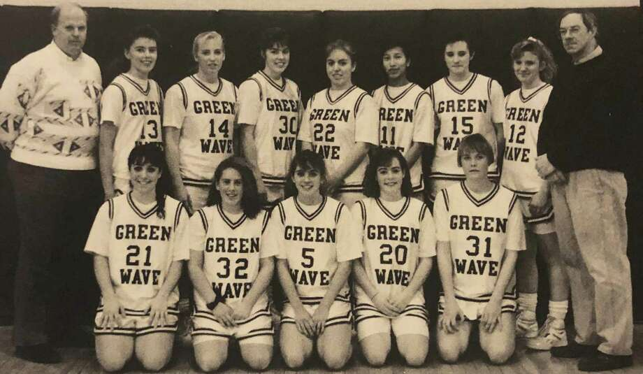 "The New Milford High School girls' varsity basketball team for the 1991-92 school year is shown above. Coach Bigham, back left, and Coach Bierbower, back right, are shown with, from left to right, in front, Christina Marazita, Diane DaCunha, Amy Fogel, Sally Miller and Anne Radday, and I nback, Jen Metcalf, Debbie Russell, Liz Miller, Megan Vermilyea, Corey Brady, Meegan O'Connell and Kathy Davis. If you have a ""Way Back When"" photograph you'd like to share, contact Deborah Rose at drose@newstimes.com or 860-355-7324. Photo: Courtesy Of NMHS 1992 Yearbook / The News-Times Contributed"