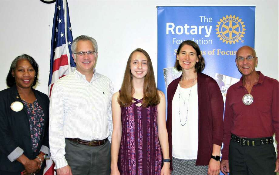 The Rotary Club of New Milford recently presented its May Student of the Month Award to Isabella Bianchi. Isabella is a member of the math, Spanish and national honor societies, has received the President's Award for Educational Excellence, the Award for Achievement of Excellence in Principles of Engineering and took First Place in Lockheed Martin's CodeQuest. She created a research project for the McCarthy Observatory with the goal of discovering new asteroids, comets and supernovae. Isabella volunteers at the observatory, tutors peers in math and ESL and is a counselor at Clatter Valley Day Camp. She plans to study engineering at Tufts University and pursue a career as an aerospace engineer to astrophysicist. Above are, from left to right, Rotarian Cheyrisse Boone, Isabella's father, Gerard Bianchi, Isabella, NMHS science teacher Erin Lucia and Rotarian Tom McSherry. Photo: Courtesy Of Rotary Club Of New Milford / The News-Times Contributed