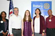 The Rotary Club of New Milford recently presented its May Student of the Month Award to Isabella Bianchi. Isabella is a member of the math, Spanish and national honor societies, has received the President's Award for Educational Excellence, the Award for Achievement of Excellence in Principles of Engineering and took First Place in Lockheed Martin's CodeQuest. She created a research project for the McCarthy Observatory with the goal of discovering new asteroids, comets and supernovae. Isabella volunteers at the observatory, tutors peers in math and ESL and is a counselor at Clatter Valley Day Camp. She plans to study engineering at Tufts University and pursue a career as an aerospace engineer to astrophysicist. Above are, from left to right, Rotarian Cheyrisse Boone, Isabella's father, Gerard Bianchi, Isabella, NMHS science teacher Erin Lucia and Rotarian Tom McSherry.