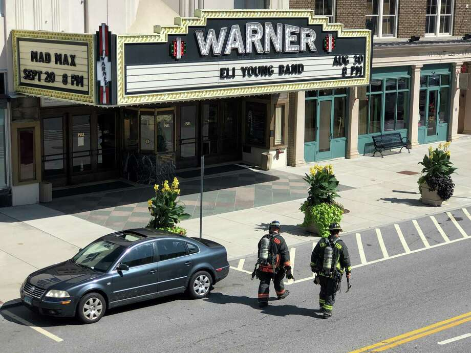 Customers wait outside while the Torrington Fire Department investigates a gas leak at 79 Main Street. The leak was discovered inside Mambo on the first floor, where it was contained. Firefighters evacuated the building as a precaution and within 30 minutes it was cleared. Photo: John Murray / Contributed Photo