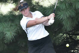 EHS junior Riley Burns hits a shot away from the trees on the seventh hole on Friday in Forsyth.