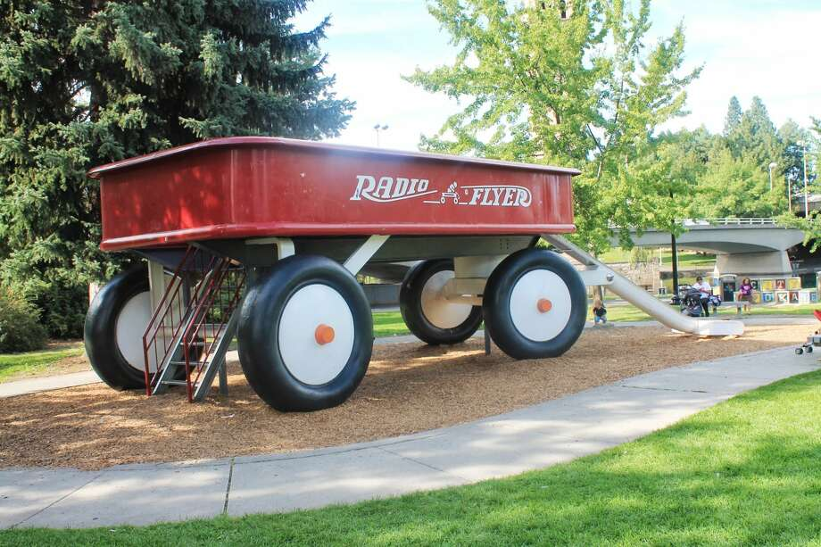 The Childhood Express Red Wagon, Spokane: Nestled along Centennial Trail lies a 12-foot tall, over 26-ton sculpture of concrete reminding us all of the simpler days. The crimson giant fits about 300 people, and despite its youthful appearance, is climbable and slideable to reminiscers of all ages. Photo: Wikimedia Commons